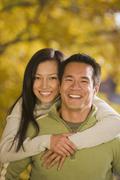 Stock Photo of Asian woman hugging boyfriend