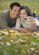 Asian couple taking own photograph Stock Photos