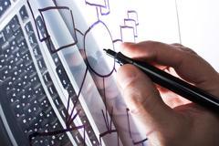 draws a diagram on a transparent glass - stock photo