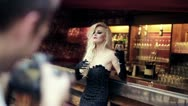 Beautiful woman on photo session in bar, steadicam shot HD Stock Footage