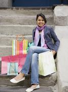 Mixed Race woman with shopping bags Stock Photos