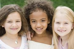 Close up of multi-ethnic girls smiling - stock photo