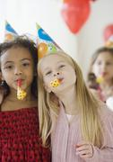 Stock Photo of Multi-ethnic girls at birthday party