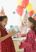 Multi-ethnic girls at birthday party Stock Photos
