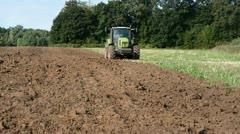 Tractor plowed autumn  field Stock Footage