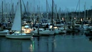 Stock Video Footage of Sailboat Coming Into Harbor at Night
