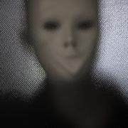 Masked figure Stock Photos