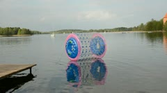 Lake Galve with zorbing ball and Trakai castle Stock Footage