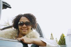 African woman in convertible car Stock Photos