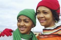 African women wearing winter hats and scarves Stock Photos