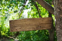 Old wooden sign on the chain Stock Photos