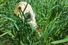 Gas masks in the grass Stock Photos
