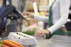 Groceries on check out counter Stock Photos