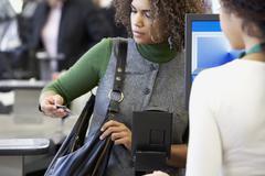 African woman looking at credit card Stock Photos