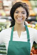 Mixed Race clerk in grocery store - stock photo