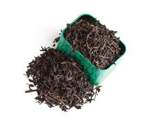 dry tea leaves in a box - stock photo