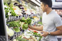Stock Photo of Hispanic man shopping for produce