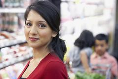 Indian mother in grocery store Stock Photos