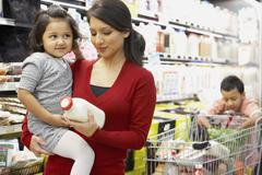 Indian mother grocery shopping with children Stock Photos