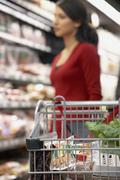 Indian woman shopping in grocery store Stock Photos