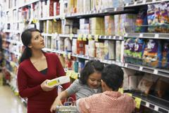 Indian mother shopping in grocery store Stock Photos