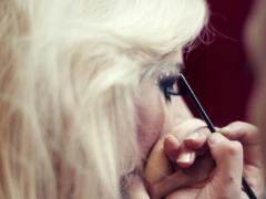 Professional visagiste applying makeup to a model, steadicam shot NTSC Stock Footage