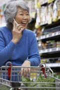 Senior Asian woman talking on cell phone Stock Photos