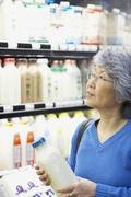 Senior Asian woman shopping in grocery store Stock Photos