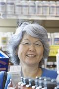 Stock Photo of Senior Asian woman shopping for vitamins