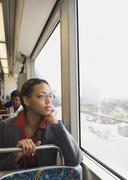 African businesswoman riding on train - stock photo