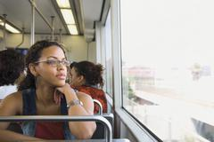 Stock Photo of African woman riding on train