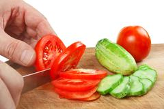 chop tomatoes and cucumbers - stock photo
