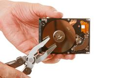 open hard drive in hand - stock photo
