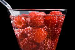 berries raspberries in a wineglass - stock photo