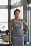 African businesswoman with hand on hip Stock Photos