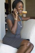 African businesswoman talking on cell phone Stock Photos