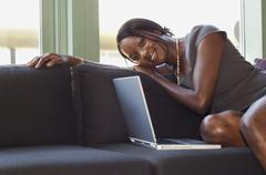 African businesswoman sitting on sofa Stock Photos