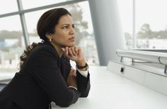 Hispanic businesswoman thinking - stock photo