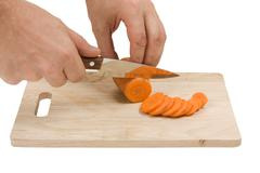 Cutting carrots on the board Stock Photos
