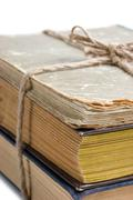 stack of old books tied with rope - stock photo