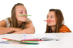 two teenage girls fool around - stock photo