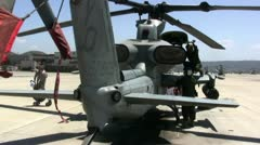 Two Marines working on helicopter Stock Footage