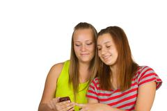 Stock Photo of portrait of lovely young women using mobile phone together