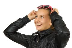 Stock Photo of happy young girl in a black leather jacket