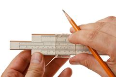 Slide rule in hand Stock Photos
