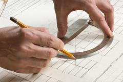 Hand draws a pencil on drawing Stock Photos