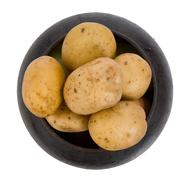 Cast iron pot with a potato Stock Photos