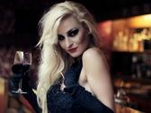 Gorgeous blonde woman by the bar counter with wine, steadicam shot NTSC Stock Footage