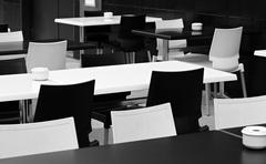 Street small cafe with bw tables and chairs. Stock Photos