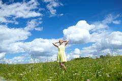 Young woman in the field. Stock Photos